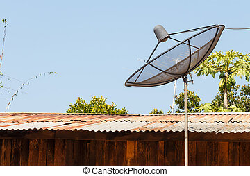 Old satellite dish and rural scene in Thailand