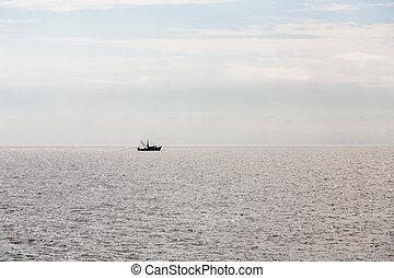Shrimp Boat Sillouette Pulling Net - A shrimp boat pulling a...