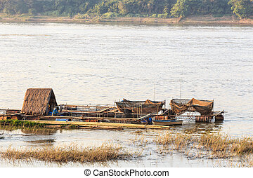 houseboat - native houseboat on Mekong river in the evening...