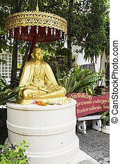 gold monk statue - gold bronze monk statue in asian temple