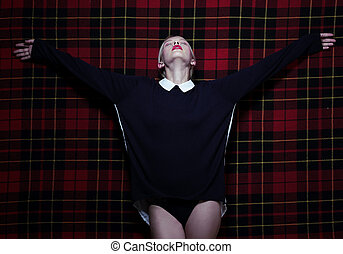 Woman in Dramatic Pose with Outstretched Hands over Purple...