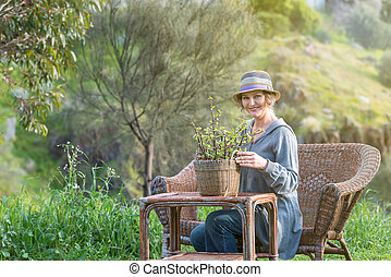 Woman in nature with   plant