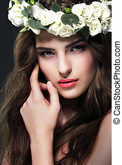 Portrait of Gorgeous Woman with Wreath of Flowers