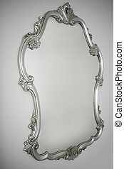 baroque silver mirror over white wall background, copy