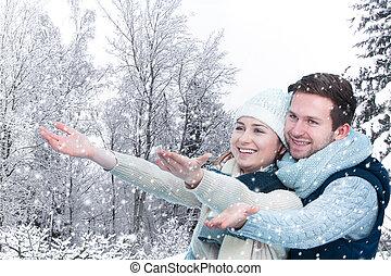 Wintertime - Happy young couple enjoying wintertime