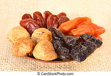 Dried fruit, dates, figs, prunes, apricots on the plate