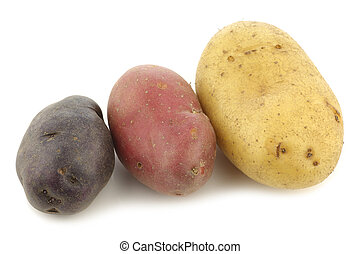 yellow, red and purple potato on a white background