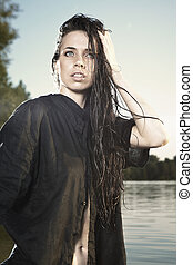 Nice woman posing y the lake - Young female model posing for...