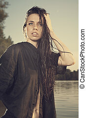 Beauty girl posing y the lake - Young female model posing...