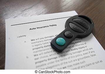 auto insurance - Auto insurance policy and key fob...