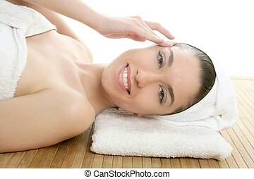 Beautiful woman face massage with white towel - Beautiful...