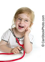 Cute little girl pretending to be a doctor with stethoscope...