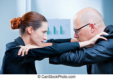business woman fighting business man
