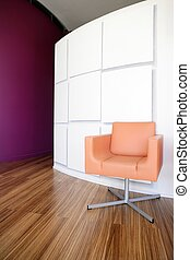 Modern office lobby with orange chair - Modern office lobby...