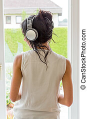 woman listening to music - woman listening music with...
