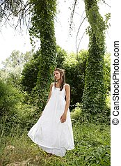 Magic woman in the forest, long white dress
