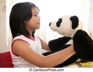 Asian girl with her panda teddy bear - Asian girl looking at...