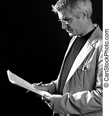 businessman reading at work, senior gray hair