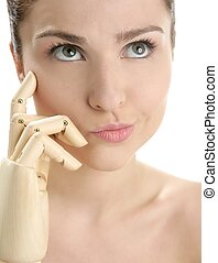 woman portrait thinking with mannequin hand - Funny woman...