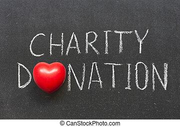 charity donation phrase handwritten on blackboard with heart...