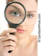 woman with magnifier lens on eye