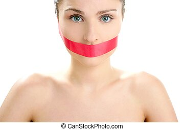 Beautiful woman with red tape on mouth portrait isolated on...