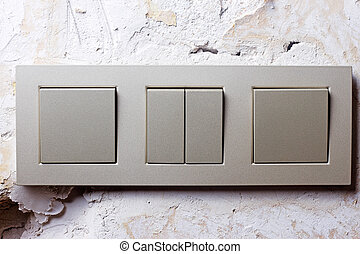 Light switch on the wall - Light switch on the repaired...
