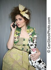 Modern fashion original woman talking phone with dalmatian...