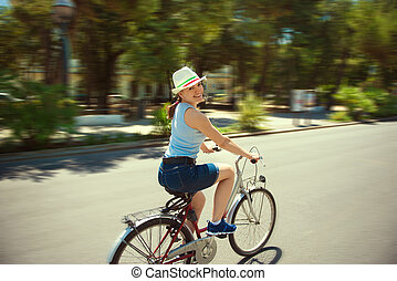 Happy young woman cycling - Happy young girl with bicycle in...