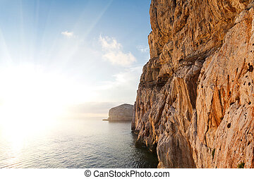 Neptune Grotto in Sardinia, Italy - high cliffs and sea,...