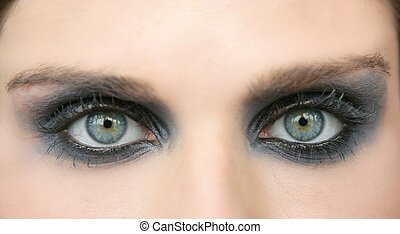 Green eyes woman, black makeup eye shadow macro