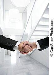Businessman handshake on modern white office - Businessman...