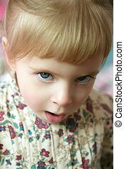 Beautiful toddler girl funny angry gesture