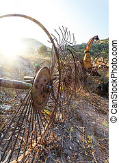 Old hay rake at sunrise, Italy - Antique Farm Equipment, Old...