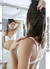 Beautiful sexy young woman posing mirror