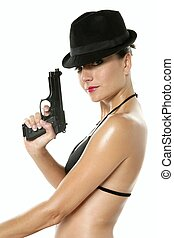 Beautiful sexy bikini woman with black gun isolated on white