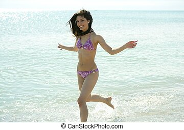 beautiful woman running in bikini on the beach - beautiful...