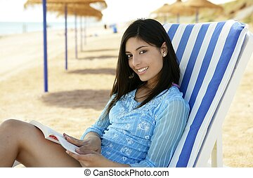 beautiful woman with a book relaxed on the beach,...
