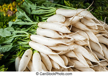 Daikon radish vegetables at asian market - Organic local...