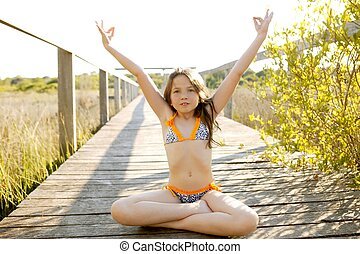 beautiful relaxed zen teen meditation in bikini, summer park...