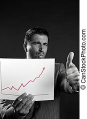 Businessman with good sales reports graph
