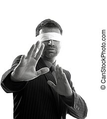 Blindfolded businessman over white background, defense...