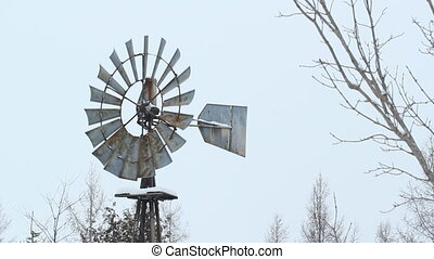 Winter windmill in rural Ontario - Winter windmill used as a...