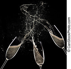 Champagne flutes on black background, celebration theme