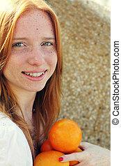 Closeup portrait of beautiful young redhead girl