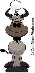 Cartoon Wildebeest Dreaming - A cartoon illustration of a...