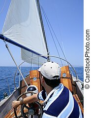 Sailor sailing in the sea. Sailboat over blue - Sailor...