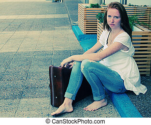 beautiful woman with vintage bag