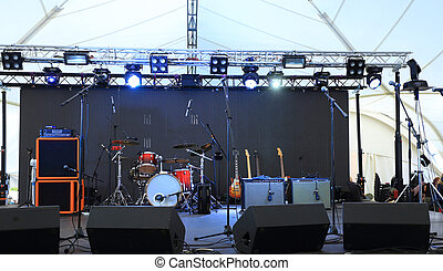 An empty Stage Before the Concert with floodlight and...