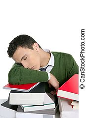 boy student sleeping over stack books over desk